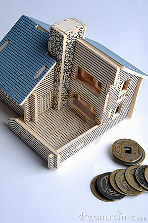 House model and aged copper coin