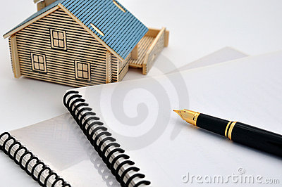 House model, fountain pen and document