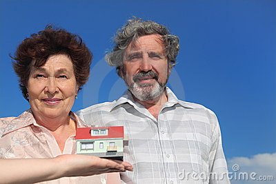 House model and old man and woman Stock Photo
