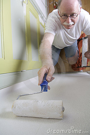 House painter with roller
