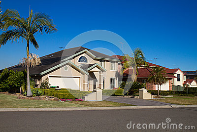 House and Palm trees on a sunny day