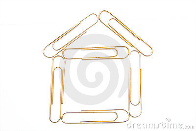 House from paper clips on the white isolated backg