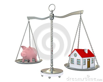 House and piggy bank on the scale