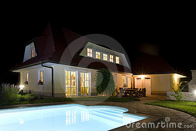 House and pool at night