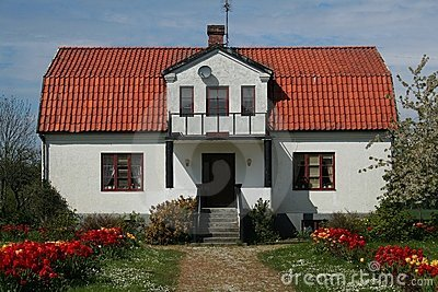 House with red roof and garden