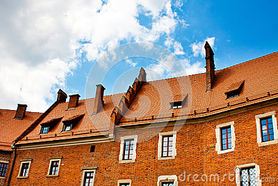 House with red tile roof and windows