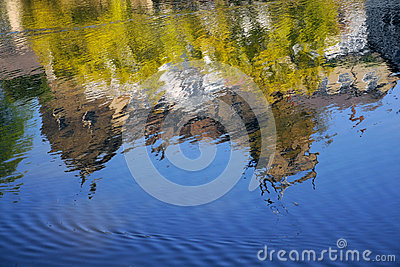 House reflection in river stream, Knaresborough UK