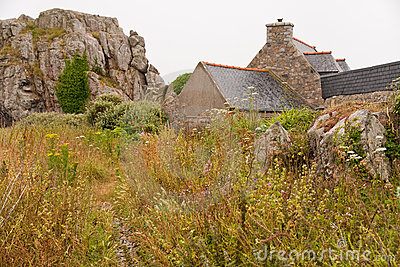House between rocks in Brittany, France
