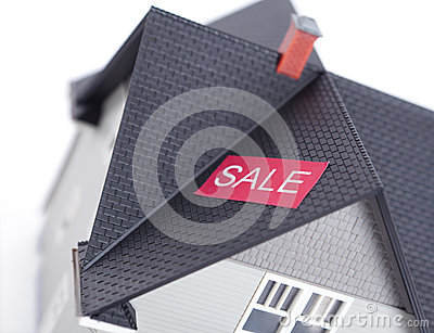 House with sale sign,  on white