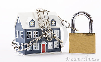 House secured with chain and padlock