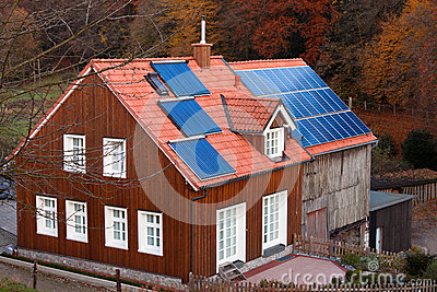 House with solar panels sun heating system on roof