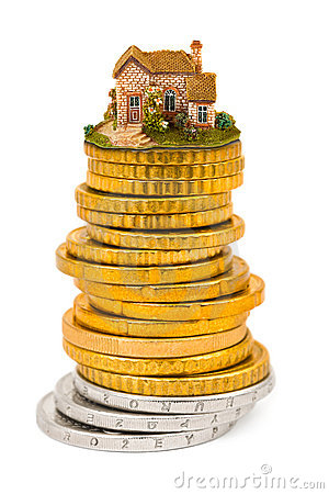 House and stack of coins