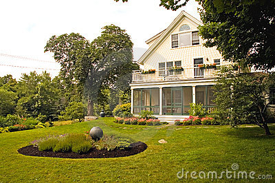 House with summer landscaping
