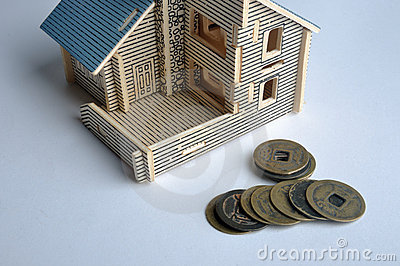 House toy and aged copper coin