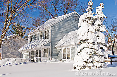 House and tree after snowstorm