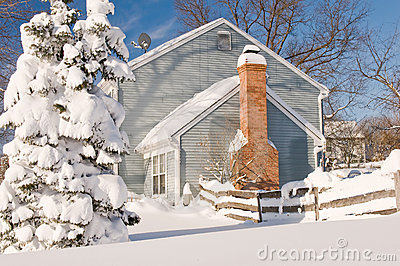 House and tree in winter snow