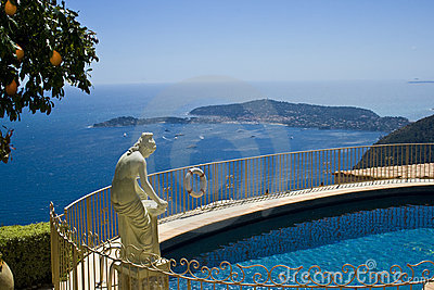 House villa with statue over pool view
