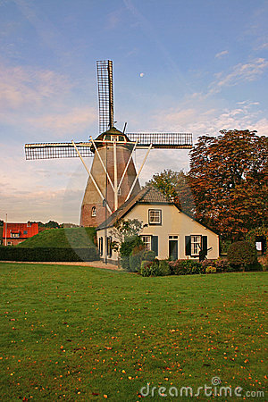 House and windmill in the Netherlands vertical
