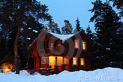House in winter wood in twilight