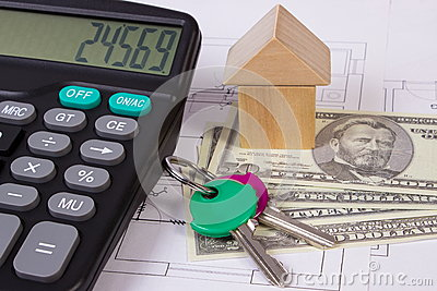 House of wooden blocks and currencies dollar with calculator on construction drawing, building house concept