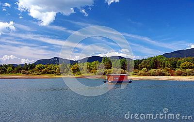 Houseboat and mountains in summer