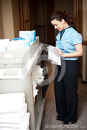 Housekeeping executive folding the hand towel