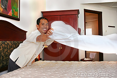 Housekeeping or room boy with big smille