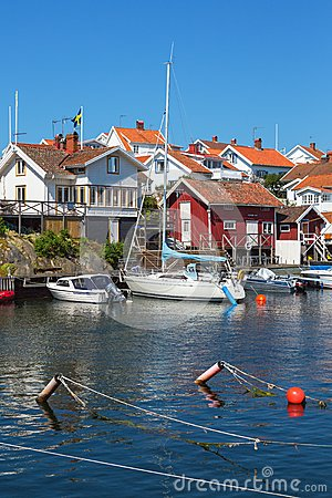 Free Houses And Boats At The Jetty Royalty Free Stock Images - 54788689