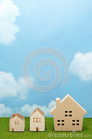 Free Houses On Green Grass Over Blue Sky And Clouds. Royalty Free Stock Photo - 83125465
