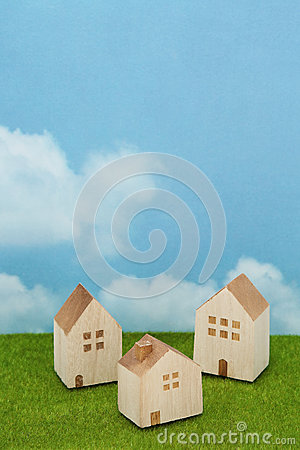 Free Houses On Green Grass Over Blue Sky And Clouds. Royalty Free Stock Photo - 83125505