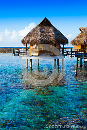 Houses Over The Transparent Quiet Sea Water Tahiti Stock