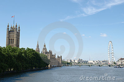 Houses of Parliament and London Eye on the Thames Editorial Stock Photo