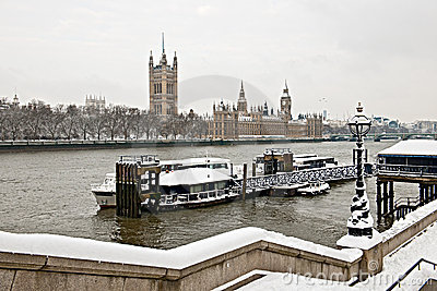Houses of Parliament, Thames, London in the snow