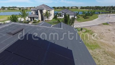 Houses with solar energy panels on roofs, small suburbian eco village, aerial shot in 4k. Houses with solar energy panels on roofs, small suburbian eco village stock footage