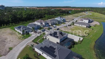 Houses with solar energy panels on roofs, small suburbian eco village, 4k. Houses with solar energy panels on roofs, small suburbian eco village stock footage