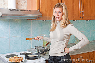 Housewife bakes pancakes