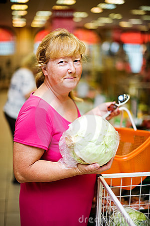 Housewife buying cabbage