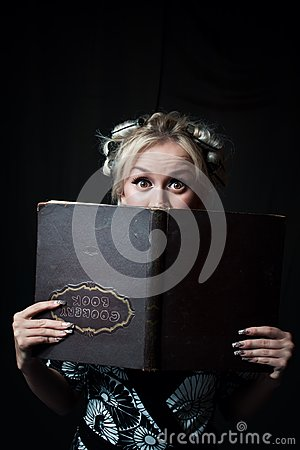 Housewife with cookery book