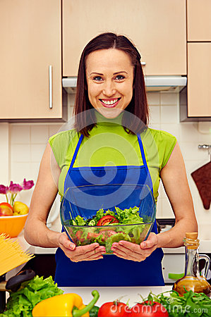 Housewife holding bowl of fresh vegetable salad