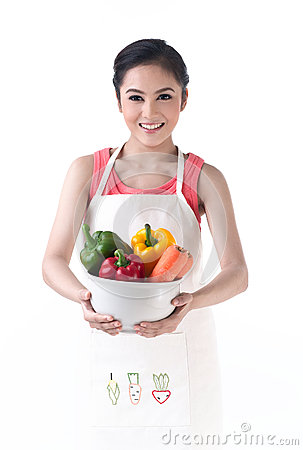 Housewife holding a bowl of vegetables