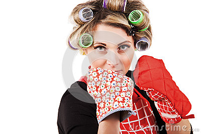 Housewife with kitchen gloves in boxing pose
