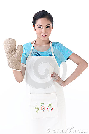 A housewife with kitchen protective glove