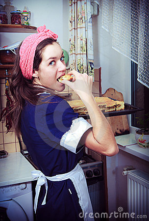 Housewife with pie in kitchen