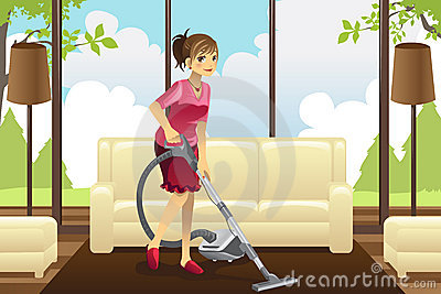 Housewife vacuuming carpet
