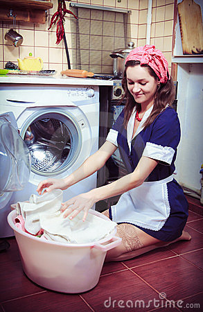 Housewife with washing machine and towels.