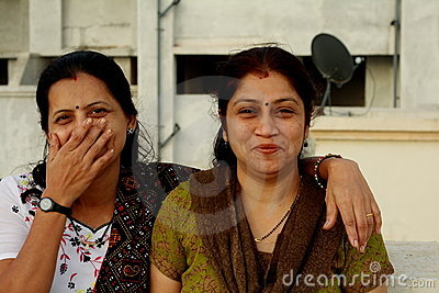Housewives laughing together