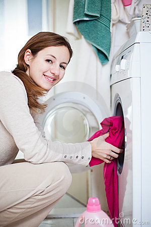 Housework young woman doing laundry
