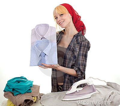 Housework - young woman ironing clothes