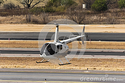 Hovering Robinson R66 Helicopter