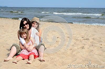 Huddled girls on the sunny beach